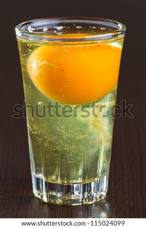 Raw egg in glass on the table