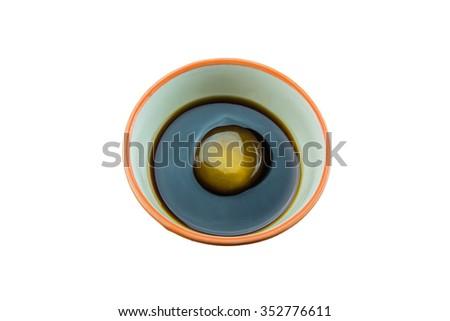 Raw Egg in soy sauce,Tamago kake gohan on white background - stock photo