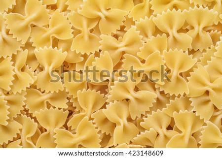 raw farfalle pasta background closeup detail - stock photo