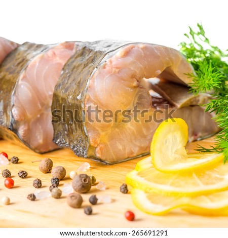 raw fillet steak of sturgeon fish with greens, lemon, different peppers and salt, isolated on white background, closeup - stock photo