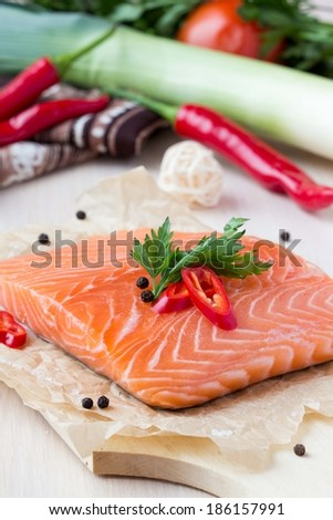 Raw fillets of red fish, salmon, cooking healthy diet dishes for dinner - stock photo