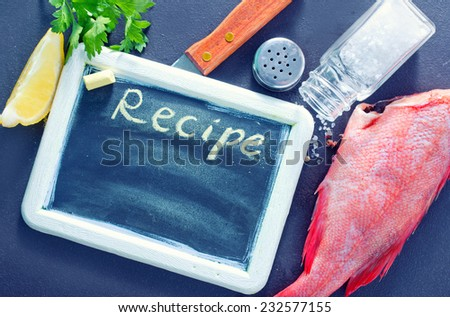 raw fish and board for recipe - stock photo