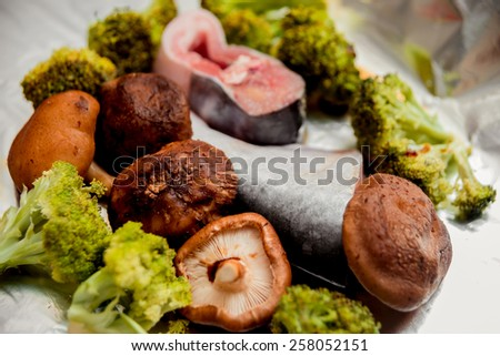 Raw fish and mushrooms on the table. Restaurant - stock photo