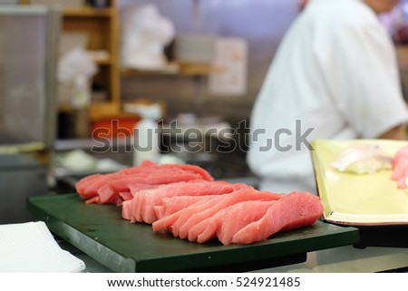 Raw fish in kitchen.