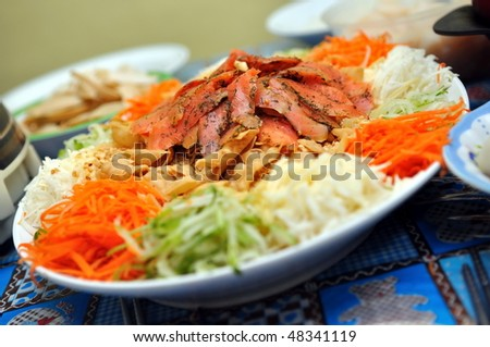 Raw fish salad (know as Lo Hei or Yu Sheng), a Chinese New Year delicacy