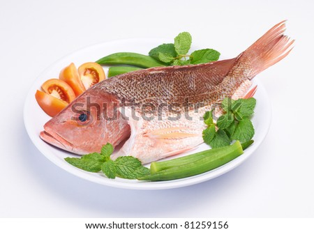 raw fish with all ingredients on plate preparing in progress - stock photo