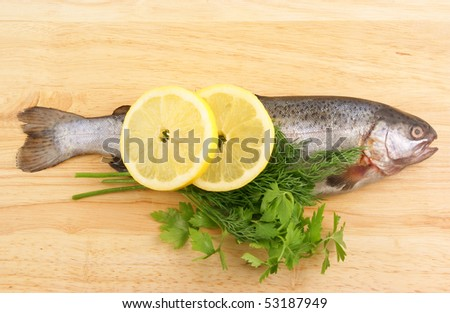 stock-photo-raw-fish-with-lemon-and-pars