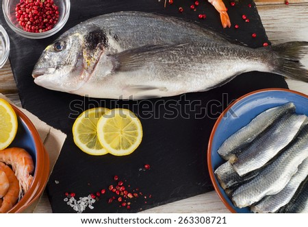 Raw Fish  with  spices , salt and shrimps - healthy food. Diet  concept. - stock photo