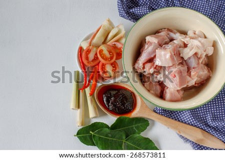 """RAw food: ingredients for """"Tom yum gai"""" or Spicy soup with chicken put on white wood table. Popular Thai food from top view. - stock photo"""