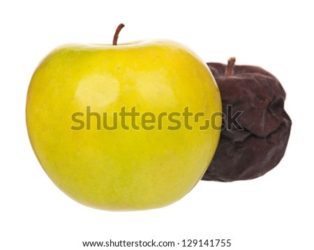 Raw fresh apple and rotten apple for comparison isolated on white background - stock photo