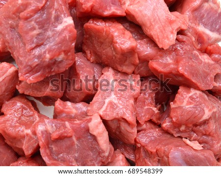 raw fresh beef cubes on background