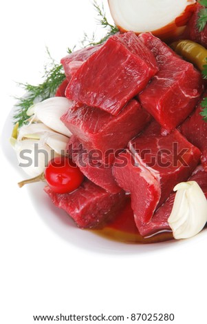 raw fresh beef meat slices in a white bowls with onion and red peppers isolated over white background - stock photo