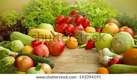 Raw fresh fruits and vegetables - organic food (vegan food) - stock photo