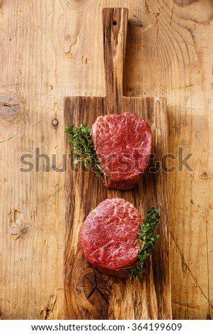 Raw fresh marbled meat Steak filet mignon on wooden background - stock photo