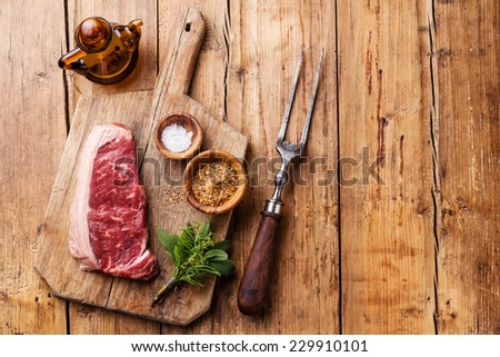 Raw fresh meat of South American premium beef New York steak Striploin on wooden background - stock photo