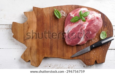 Raw fresh meat on wooden board, selective focus - stock photo