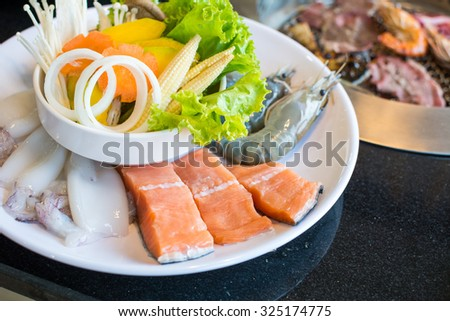 Raw fresh salmon and shrimp, squid in BBQ Dinner Set - stock photo