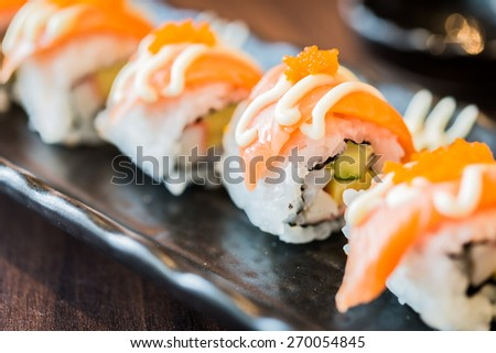 Raw fresh Salmon sushi roll maki - japanese food - stock photo