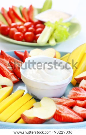 Raw  fruits and vegetables with cream cheese and yogurt dip - stock photo