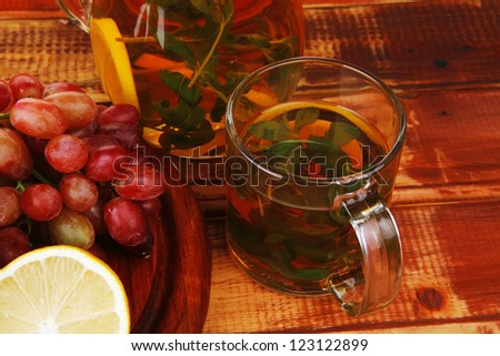 raw fruits served with tea on wood