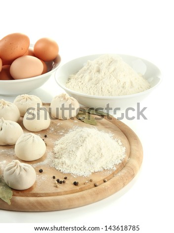 Raw Georgian khinkali and ingredients on wooden desk, isolated on white