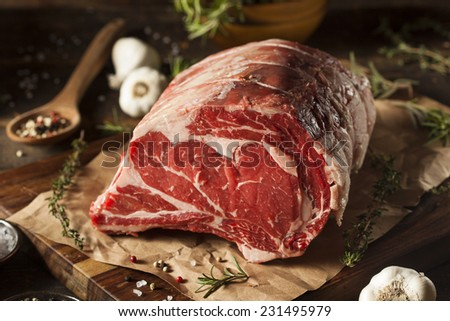 Raw Grass Fed Prime Rib Meat with Herbs and Spices - stock photo