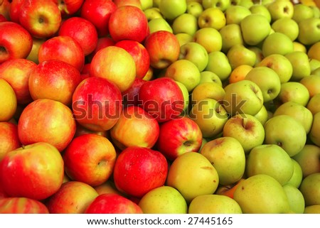 raw green and red apple heap on market - stock photo