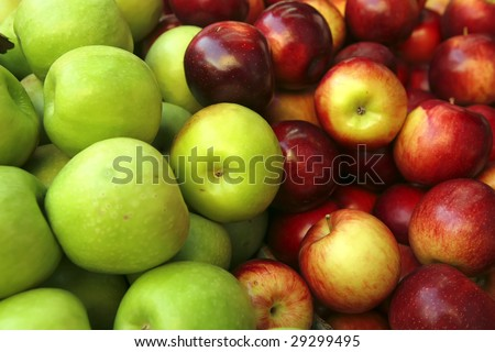 raw green and red apple heap on market show tray - stock photo