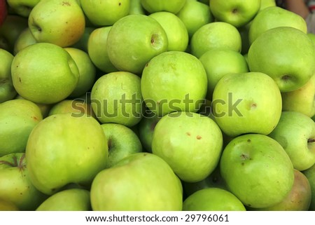 raw green apple heap on market show tray