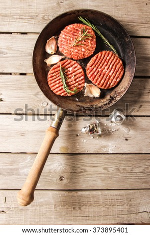 Raw Ground beef meat Burger steak cutlets on  wooden background  Flat Lay. Top view. - stock photo