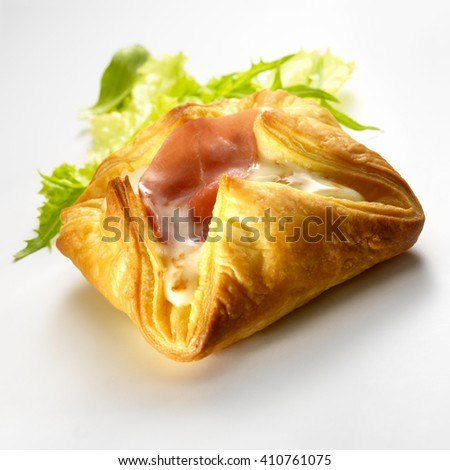 Raw ham puff pastry and fresh salad, isolated on a white background - stock photo