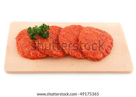 Raw hamburgers with parsley isolated over white - stock photo
