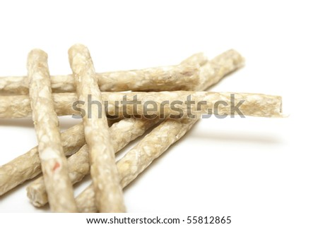 Raw Hide Sticks for Dogs - stock photo