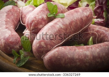 raw homemade sausage on a wooden board  - stock photo