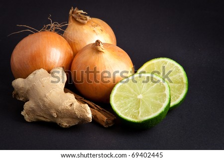 Raw ingredients for a meal on black background - stock photo