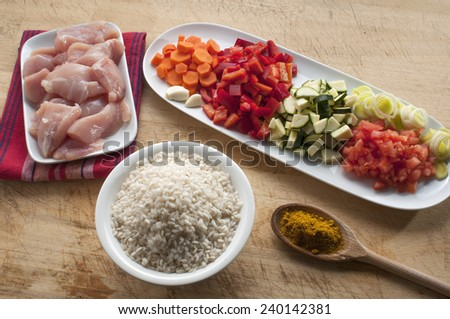 raw ingredients ready to prepare chicken curry with vegetables - stock photo