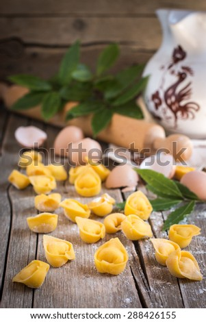 Raw italian cappelletti - fresh home made pasta stuffed with cheese - stock photo