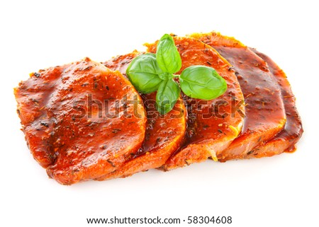 raw juicy steaks with sauce isolated on white background - stock photo