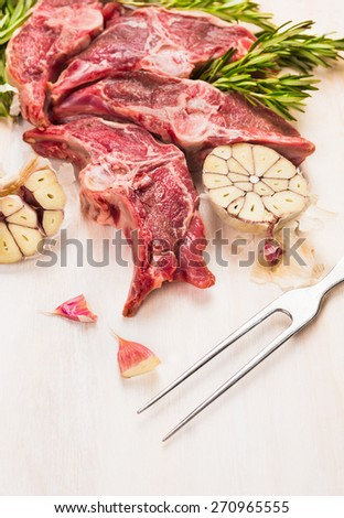 Raw lamb loin chops meat on white wooden background, close up - stock photo