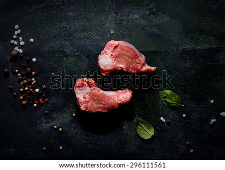 raw lamb on a black background  - stock photo