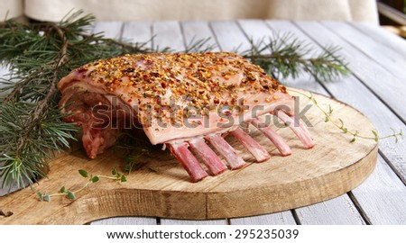 Raw lamb ribs to the Christmas and New Year's wooden table - stock photo