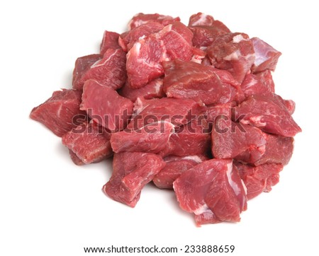 Raw lamb steak meat, diced for making into kebabs. - stock photo