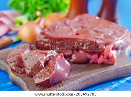 raw liver on board - stock photo
