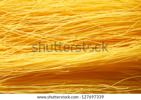 Raw, long vermicelli with eggs - stock photo