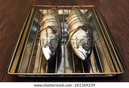 Raw mackerel fish ready for smoke-dried, close up view - stock photo