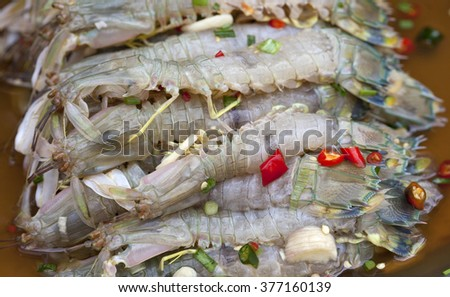 raw Mantis shrimp and spicy sauce, seafood thailand (spicy salad shrimp in fish sauce).