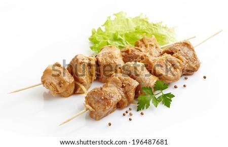 raw marinated pork kebab on wooden skewers - stock photo