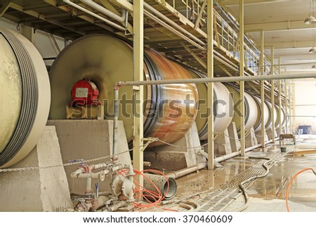 Raw material tank in a production workshop, closeup of photo