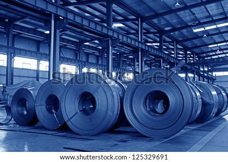 raw materials strip in the internal of a steel manufacturing plant, Luannan County, Hebei Province of China. - stock photo