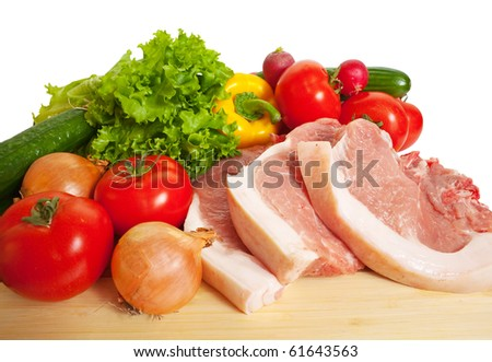 Raw meat and vegetables. Isolated over white - stock photo